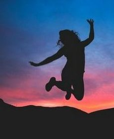 person jumping with joy