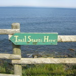 trail starts sign on fence