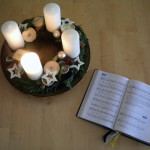 advent wreath and hymn book