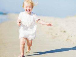 baby running on beach