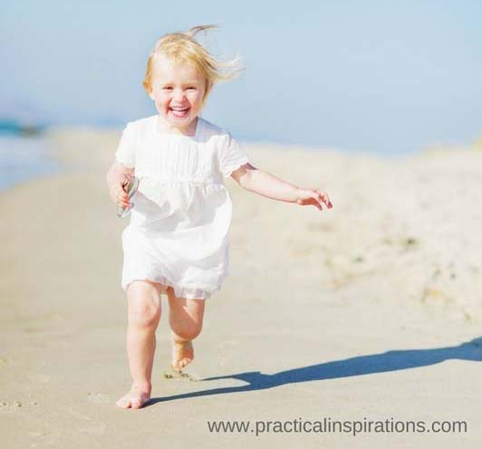 baby running on beach